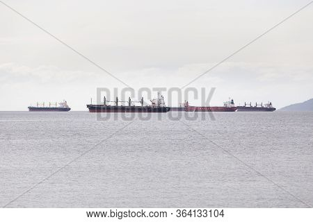 Vancouver, Bc, Canada - Apr 26, 2020: Cargo And Tanker Ships Moored In Vancouver Harbor Awaiting To