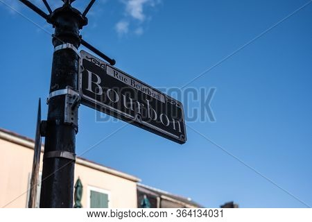 New Orleans, United States: February 27, 2020: Bourbon Street Sign On Blue Sky
