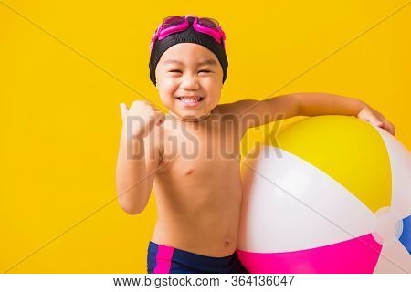 Summer Vacation Concept, Portrait Asian Happy Cute Little Child Boy Smiling In Swimsuit Hold Beach B