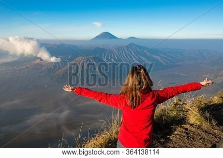 Back View Of Women Tourist Looking To The Spectacular View Of Mount Bromo An Active Volcano Part Of