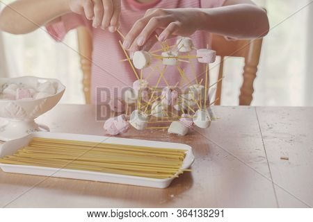 Child Building Tower With Spaghetti And Marshmallow Learning Remotely At Home, Stem Science, Homesch