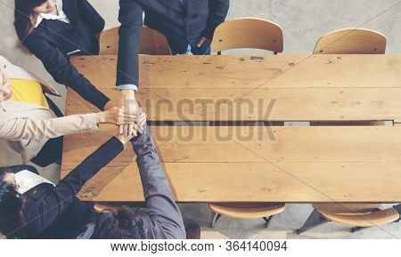 Teamwork Marketing Team Collaborate In Office. Group Of People Holding Hands Together Showing Power.