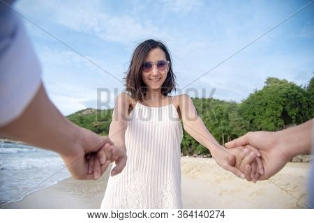 Couple Lover Hold Hands Together On Tropical Summer Beach. Focus On Girlfriend Smiling To Boyfriend