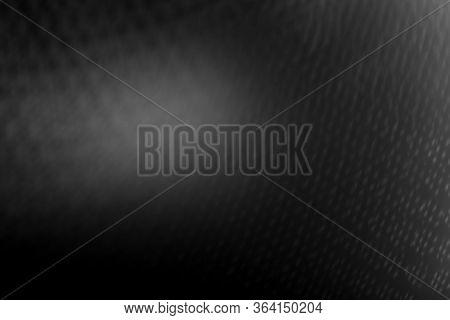 Black Seamless Blurry Background With A Dim Spotlight. Black Minimalism. Black Abstract Background.