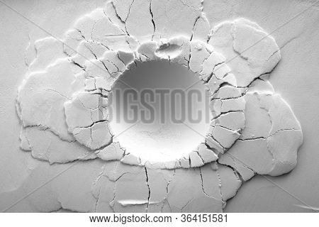 A Crater On White Powder Background. Round Crater With Cracks.