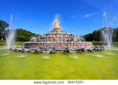 Beautiful fountain against The Herrenchiemsee Palace inspired by Versailles. Bavaria, Germany.