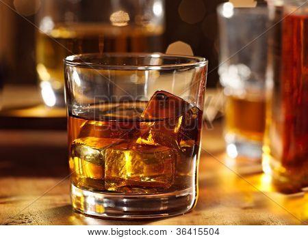 Highball whiskey glass at bar close up