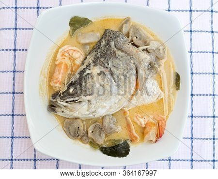 Asian Sea Bass Or Barramundi Fish In The Spicy And Sour Soup, Tom Yum, Thai Food