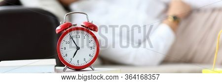 Girl Is Tired And Lies On Table An Alarm Clock. Woman Is Tired Spending Lot Time Shopping. Female Sh