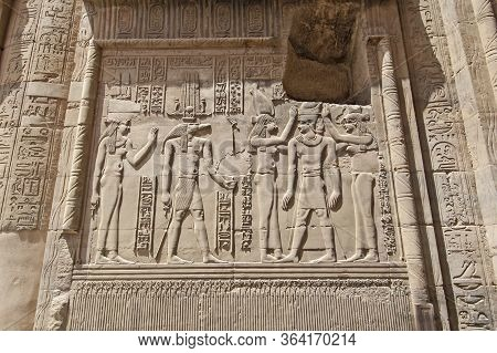 Hieroglypic Carvings On Wall At The Ancient Egyptian Temple Of Kom Ombo In Aswan With Crocodile God