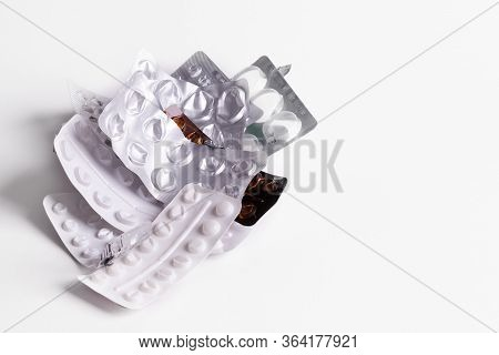 Empty Pill Packets Piled Up On A White Isolated Background. Text Space And Copy Space.