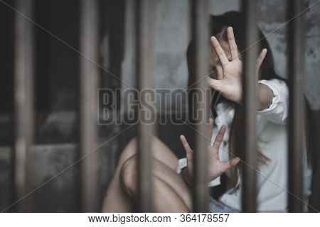 The Hopeless Slave Girl Is In A Cell. Women Violence And Abused Concept, Imprisonment, Female Prison