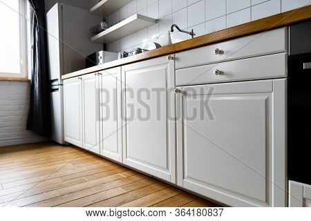 Furniture And Appliances: Bright White Cabinets With Wooden Countertop, Electric Cooker, Induction H