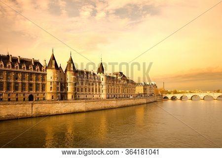 The Conciergerie At Justice Palace And Pont Neuf Bridge Over The Seine River, Ile De La Cite, Paris,