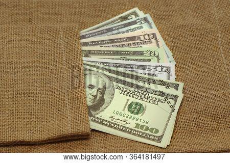 Varites Dollar Money ,the Usa Banknote Inserted In A Sack Bag On Big Sack Bag.