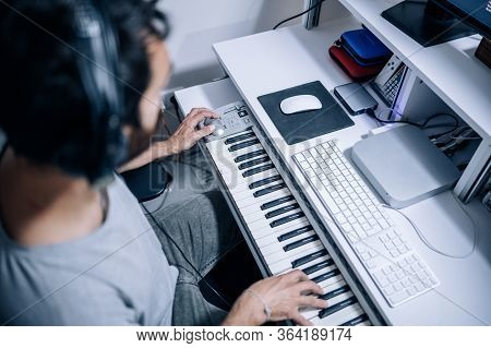 Top View Of Musician Playing Electric Piano At Home Recording Studio.musician Desk. Music,e-learning