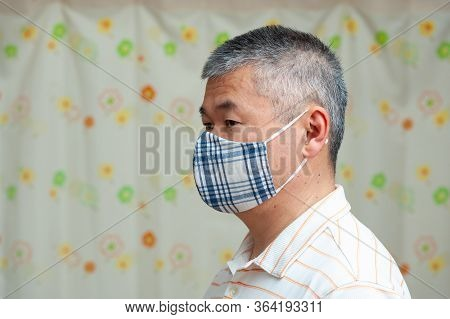 Profile Side View Portrait Of Middle Aged Asian Man Wearing (diy) Homemade Fabric Face Mask For Prot