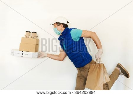 Delivery Man In Uniform Face Mask Gloves Carrying Many Cardboard Boxes, Running And Hurrying To Deli