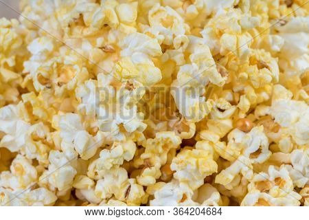 Heap of delicious popcorn, isolated on white background. Scattered salted popcorn, texture backgroun