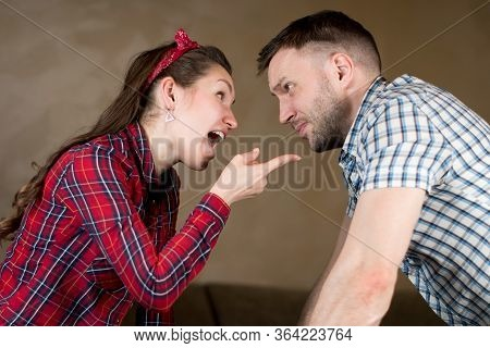 Husband And Wife Swear. Wife Chastises Husband For Something, Pointing Finger At Him