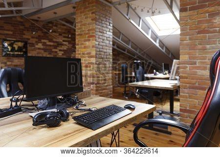 Interior Of Contemporary Design Corporate Office Breakout Area In City, Empty Screen