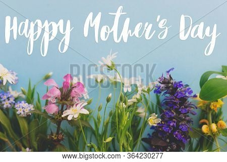 Happy Mother's Day Greeting Card. Colorful Spring Flowers Border On Blue Background Flat Lay With Gr