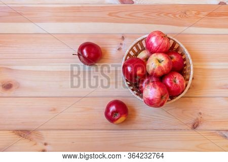 Basket With Red Ripe Apples On Wooden Background. Top View, Copy Space.