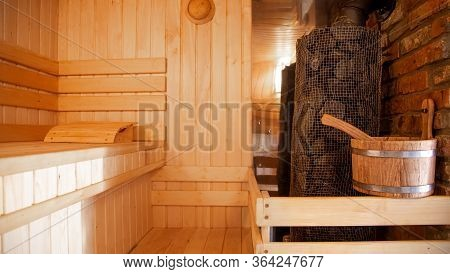 Interior Of A Wooden Russian Sauna With Traditional Items For Use.