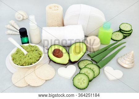 Vegan skin care beauty treatment for anti ageing and rejuvenation with aloe vera, cucumber & avocado, with facial mask, essential oil, moisturising cream, gel, oil and cleansing products.
