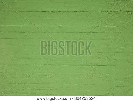 A Textured Concrete Wall Painted Green Colour