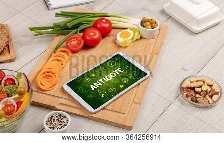 Healthy Tablet Pc compostion with ANTIDOTE inscription, immune system boost concept