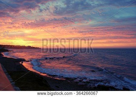 Sunrise Over The Costa Del Sol Coastline, Mijas Costa, Malaga Province, Andalucia, Spain.
