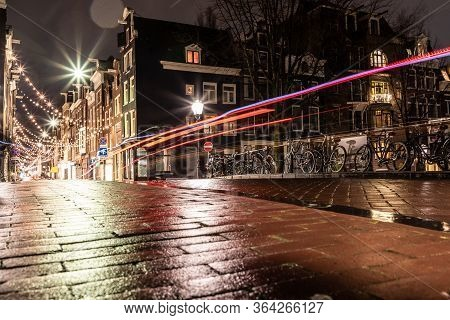 Night Lights Of Building And Biclycles In Amsterdan