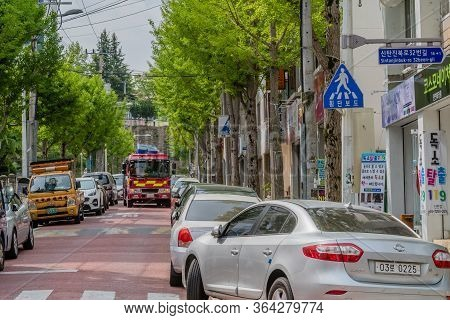 Daejeon, South Korea; May 2, 2020:red Fire Truck Making Its Way Between Parked Cars On Crowed City S