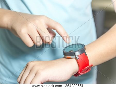 Close Up Of Young Man Using Smart Watch.