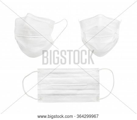 Medical Shielding Bandage Isolated Against The White Background. Some Pieces White Medical Masks In
