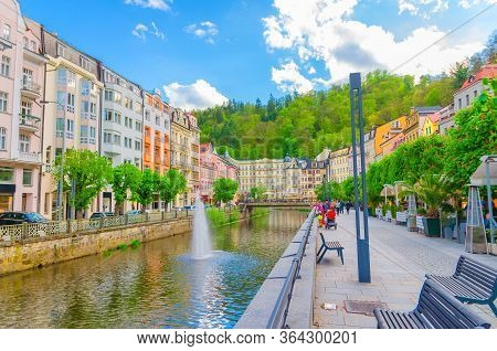 Karlovy Vary, Czech Republic, May 10, 2019: Carlsbad Historical City Centre, Tepla River Central Emb