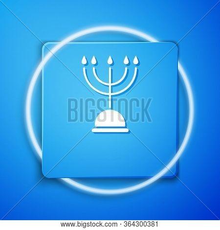 White Hanukkah Menorah Icon Isolated On Blue Background. Hanukkah Traditional Symbol. Holiday Religi