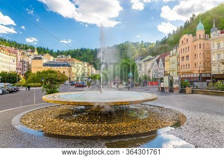 Karlovy Vary, Czech Republic, May 10, 2019: Hot Spring Geyser Vridlo At Carlsbad Historical City Cen