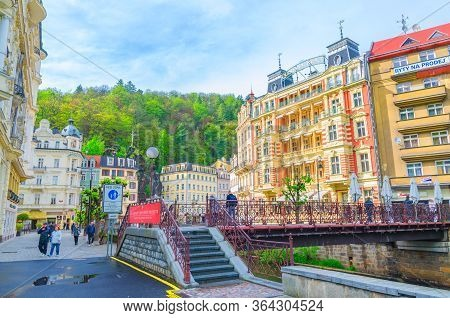 Karlovy Vary, Czech Republic, May 11, 2019: Carlsbad Historical City Centre With Tepla River Central