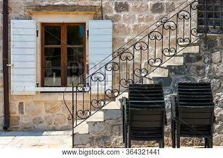 Authentic House With A Stone Wall And A Beautiful Window With Shutters, With A Side Staircase, In Th
