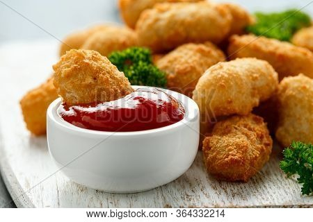 Crispy Battered Scampi Nuggets With Ketchup On White Wooden Board