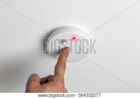 Testing Home Smoke Alarm Detector. Stay Home Safe. Home Control And Security. Smoke Detector