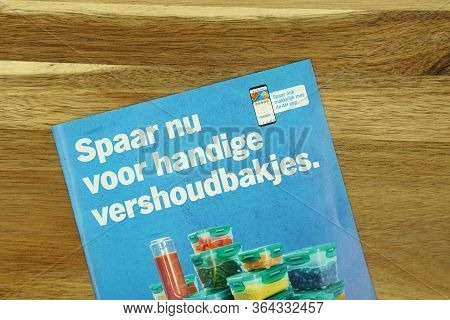 Zaandam, The Netherlands - May 3, 2020:  Dutch Savings Book For Food Containers Issued By Grocery St