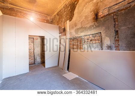 Working Process Of Installing Frames For Plasterboard - Drywall And Construction Tools In Apartment