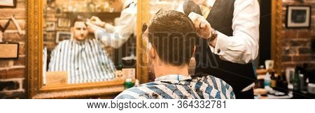 Barbershop Master Cuts Clients Hair With Scissors Banner