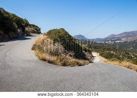 Country Of Central Crete, With A High Mountain In The Background. Line And Curve An Asphalt Road, Li