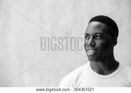 Young Happy Handsome African Man Thinking In Black And White
