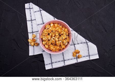 Close-up Roasted Popcorn In Ceramic Plate On Checkered Background. Flat Lay Concept Of Homemade Popc