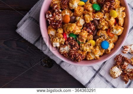 Fresh Caramel Popcorn And Colorful Buttons Mix In Bowl. Checkered White Napkin.